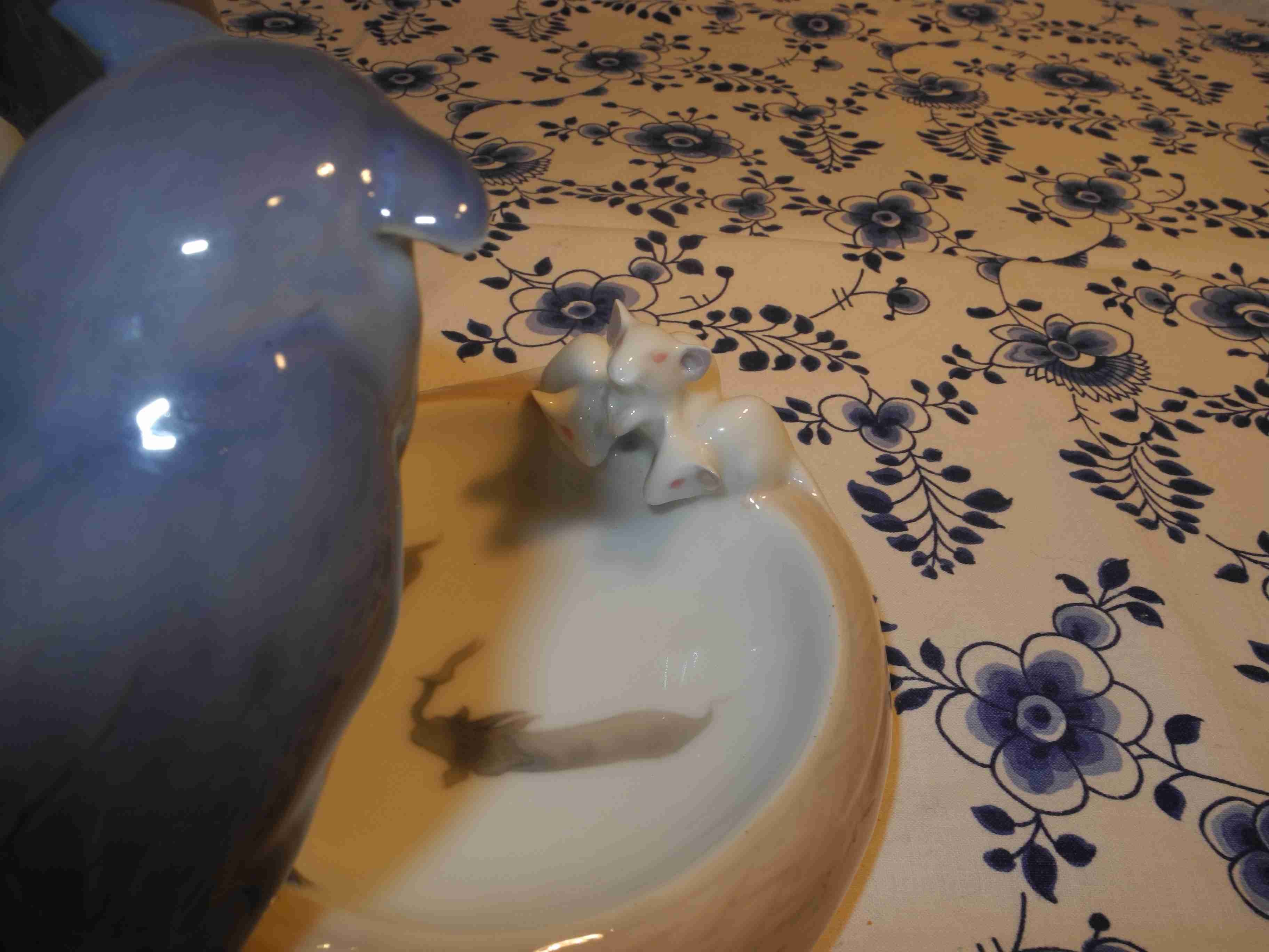 Owl with mice dish